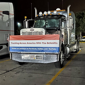 Trucking Across America with the Schmitts banner on a semi truck